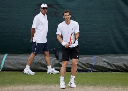 Andy Murray of Britain (R) trains with his coach Ivan Lendl during a training session at the Wimbledon Tennis Championships, in London June