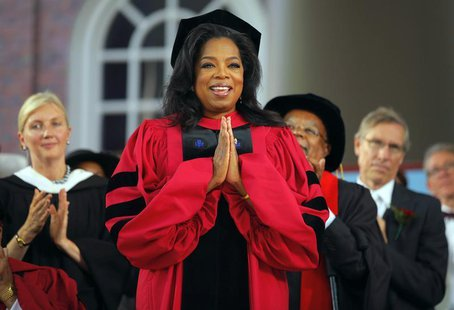 Media mogul Oprah Winfrey acknowledges the cheers from students and audience as she receives an honorary Doctor of Laws degree during Harvar