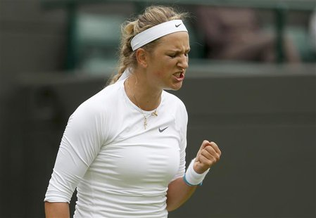 Victoria Azarenka of Belarus reacts during her women's singles tennis match against Maria Joao Koehler of Portugal at the Wimbledon Tennis C