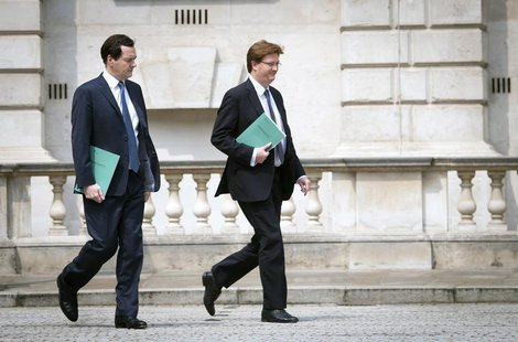 Britain's Chancellor of the Exchequer George Osborne and Chief Secretary to the Treasury Danny Alexander leave the Treasury for the House of