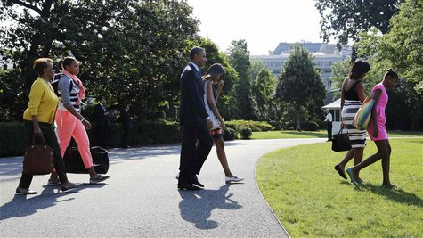 U.S. President Barack Obama (C) and his family walk to the helicopter to depart for travel to Africa from the South Lawn of the White House