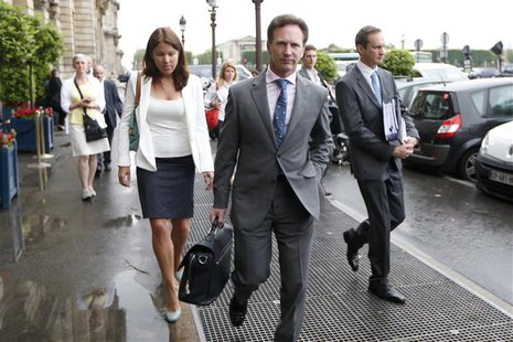 Red Bull team principal Christian Horner (C) arrives to attend an hearing at the FIA headquarters in Paris June 20, 2013. REUTERS/Charles Pl