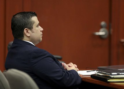 George Zimmerman seated in the courtroom for his second-degree murder trial for the 2012 shooting death of Trayvon Martin in Seminole circui