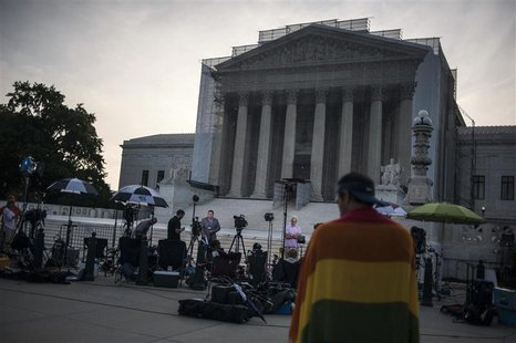 Journalists stake out positions early in the morning to report on decisions expected in two cases regarding same-sex marriage at the U.S. Su