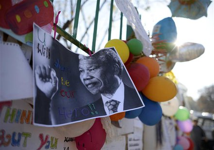 "A photograph of former South African President Nelson Mandela with a handwritten message ""You will always be our hero"", is attached to the w"