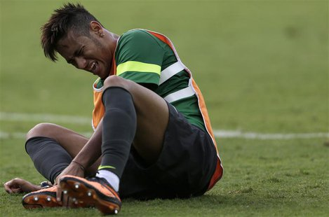 Brazil's national soccer team player Neymar reacts during a training session in Belo Horizonte June 25, 2013. Brazil will play against Urugu
