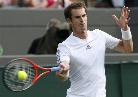 Andy Murray of Britain hits a return to Lu Yen-Hsun of Taiwan in their men's singles tennis match at the Wimbledon Tennis Championships, in