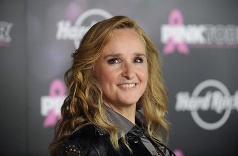 Singer Melissa Etheridge poses for photographers after receiving a star on the Hollywood Walk of Fame in Los Angeles September 27, 2011. REU