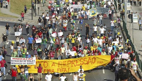 Brazilians participate in a demonstration near the Mineirao Stadium in Belo Horizonte, June 26, 2013. REUTERS/Jackson Romanelli