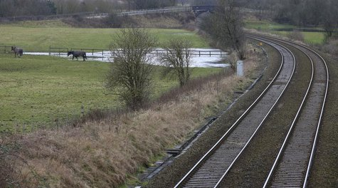 Existing rail tracks carve through fields near to the planned location of the new HS2 high speed rail link as it passes by the village of As