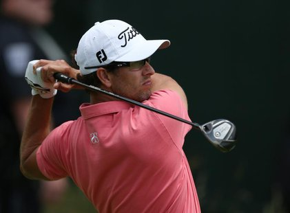 Australia's Adam Scott tees off on the 18th hole during the second round of the 2013 U.S. Open golf championship at the Merion Golf Club in