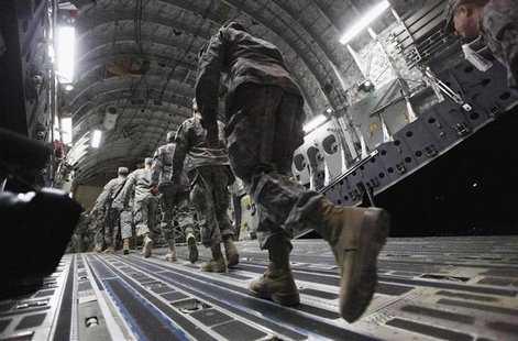 Soldiers from the 3rd Brigade, 1st Cavalry Division board a C-17 transport plane to depart from Iraq at Camp Adder, now known as Imam Ali Ba