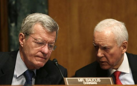 Senator Max Baucus (D-MT) (L), the chairman of the Senate Finance Committee, and Senator Orrin Hatch (R-UT), the co-chair, confer during tes