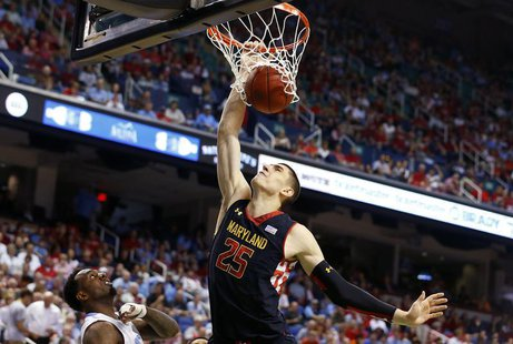 Maryland Terrapins center Alex Len (R) dunks the ball over North Carolina Tar Heels guard P.J. Hairston (L) during the first half of their A