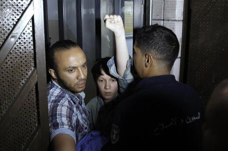 Marguerite Stern of France, a member of the women's rights group Femen, gestures after she is released from prison in Tunis June 27, 2013. A