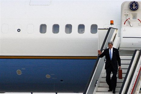 U.S. Secretary of State John Kerry steps off his plane as he arrives in Amman airport, June 26, 2013. REUTERS/Majed Jaber