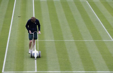 A groundsman prepares a white line on Centre Court at the Wimbledon Tennis Championships, in London June 24, 2013. REUTERS/Eddie Keogh