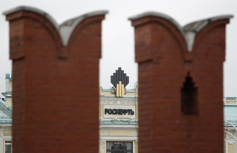 The logo of Russia's top crude producer Rosneft is seen at the company's headquarters, behind the Kremlin wall, in central Moscow May 27, 20