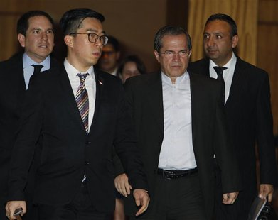 Ecuador's Foreign Minister Ricardo Patino (2nd R) leaves his hotel in Singapore June 27, 2013. REUTERS/Edgar Su