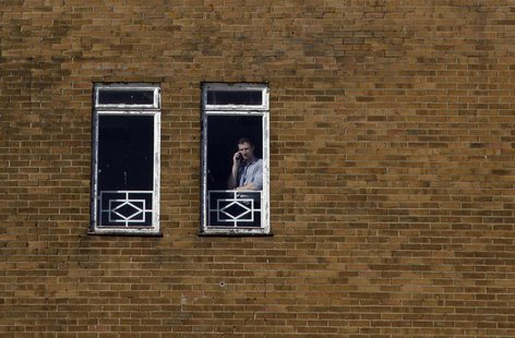A man uses a mobile phone in Ashford, southern England April 30, 2013. REUTERS/Stefan Wermuth