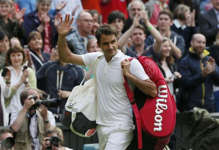 Roger Federer of Switzerland walks off the court after being defeated by Sergiy Stakhovsky of Ukraine in their men's singles tennis match at