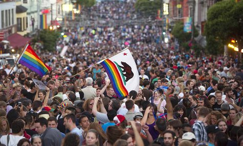 Thousands of revelers fill Castro St. in San Francisco, California to celebrate the United States Supreme Court's rulings on California's Pr