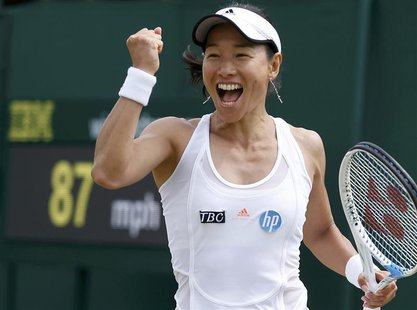 Kimiko Date-Krumm of Japan celebrates after defeating Alexandra Cadantu of Romania in their women's singles tennis match at the Wimbledon Te