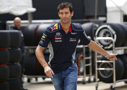 Red Bull Formula One driver Mark Webber of Australia arrives ahead of the British Grand Prix at the Silverstone Race circuit, central Englan