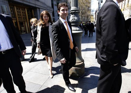 Former Goldman Sachs Group Inc. trader Fabrice Tourre (C) leaves the United States Court in New York City, April 26, 2013. REUTERS/Mike Sega