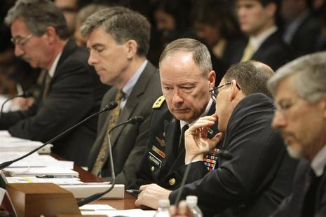 National Security Agency (NSA) Director U.S. Army General Keith Alexander (C) confers with FBI Deputy Director Sean Joyce (2nd R) as they te