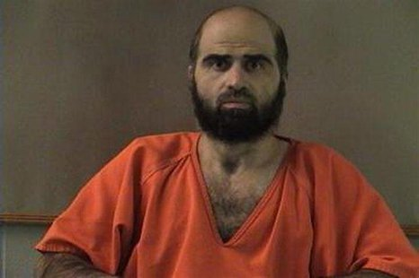 Nidal Hasan, charged with killing 13 people and wounding 31 in a November 2009 shooting spree at Fort Hood, is pictured in an undated handou