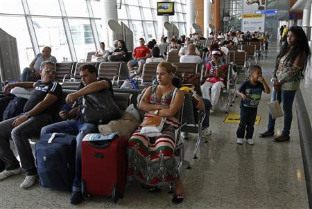 People wait before boarding an Aeroflot Airbus A330 plane heading to the Cuban capital Havana at Moscow's Sheremetyevo airport June 27, 2013. Credit: Reuters/Alexander Demianchuk