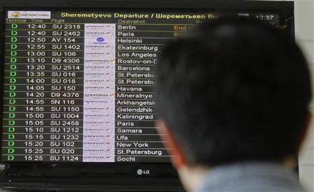 A man looks at a flight information board at Moscow's Sheremetyevo airport June 27, 2013.  REUTERS/Alexander Demianchuk
