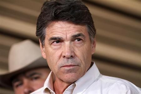 Texas Governor Rick Perry answers questions from the media after taking an aerial tour over the fertilizer plant explosion site in West, Texas, April 19, 2013. Credit: Reuters/Jaime R. Carrero