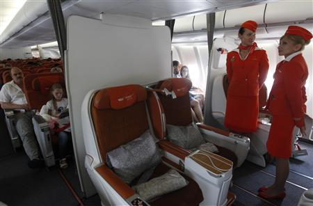 People sit onboard an Aeroflot Airbus A330 heading to the Cuban capital Havana at Moscow's Sheremetyevo airport June 27, 2013.  REUTERS/Maxim Shemetov