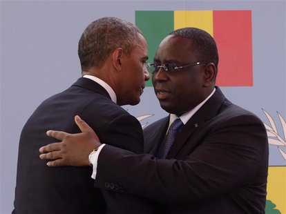 U.S. President Barack Obama (L) and Senegal President Macky Sall embrace after their joint news conference at the Presidential Palace June 2