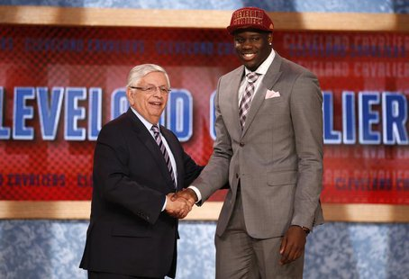 Anthony Bennett from the University of Nevada Las Vegas (UNLV) shakes hands with NBA Commissioner David Stern (L) after being selected by th
