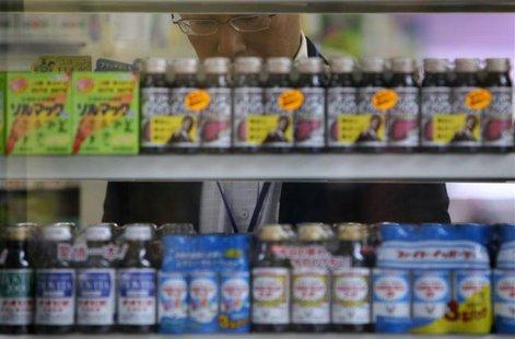A man shops inside a drugstore in Tokyo June 28, 2013. REUTERS/Yuya Shino