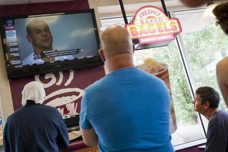 People watch a television at Dunkin Donuts as New England Patriots tight end Aaron Hernandez is arraigned next door in the Attleborough Dist