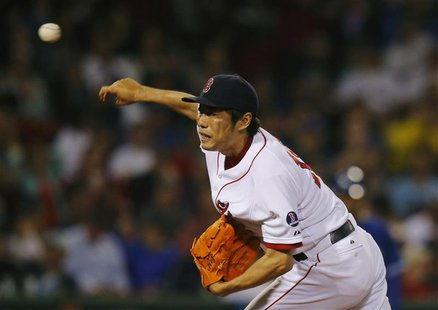 Boston Red Sox Koji Uehara pitches against the Toronto Blue Jays in the ninth inning of their MLB American League baseball game at Fenway Pa