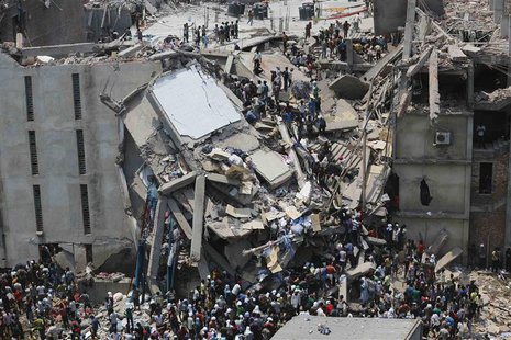 People rescue garment workers trapped under rubble at the Rana Plaza building after it collapsed, in Savar, 30 km (19 miles) outside Dhaka i