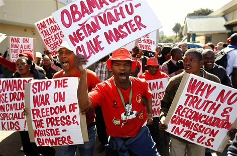 Protesters carry placards as they protest against the visit of U.S. President Barack Obama in Pretoria, June 28, 2013. REUTERS/Siphiwe Sibek