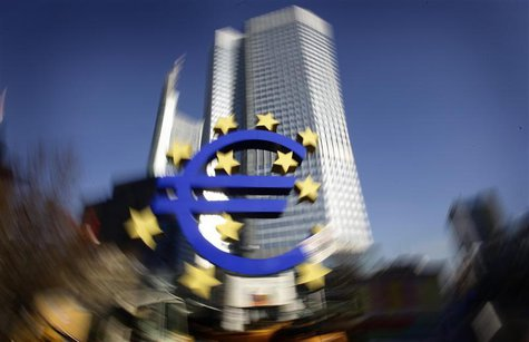 The Euro sculpture is pictured in front of the headquarters of the European Central Bank (ECB) in Frankfurt, January 17, 2012. REUTERS/Kai P