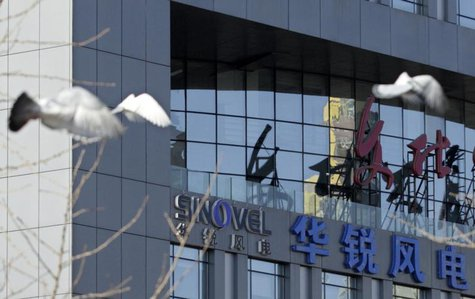 Pigeons fly past the company logo of Sinovel Wind Co., Ltd. outside its head office in Beijing, January 6, 2011. REUTERS/Soo Hoo Zheyang