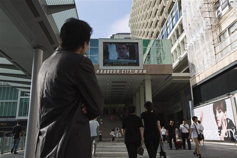 Edward Snowden, a former contractor at the National Security Agency (NSA), is seen during a news broadcast on a screen at a shopping mall in