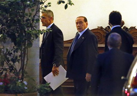 Italy's former Prime Minister Silvio Berlusconi (C) leaves his residence at Grazioli palace, downtown Rome June 25, 2013. REUTERS/Tony Genti