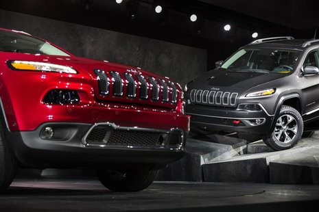 A Limited and a Trailhawk model 2014 Jeep Cherokee are seen on stage after being unveiled at the New York International Auto Show in New Yor