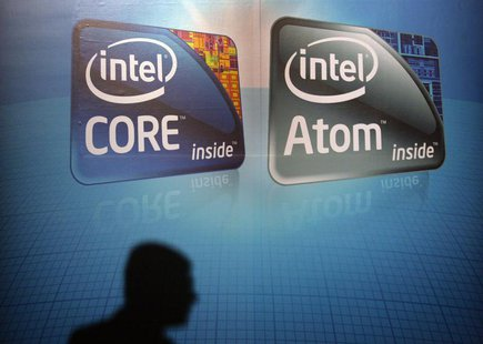 A shadow is cast on an Intel advertisement at the Computex 2010 computer fair in Taipei June 1, 2010. REUTERS/Pichi Chuang