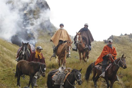 Andean people ride their horses during a protest march against Newmont Mining's Conga project, along the Perol lake in Peru's region of Caja