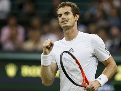 Andy Murray of Britain reacts after defeating Tommy Robredo of Spain in their men's singles tennis match at the Wimbledon Tennis Championshi